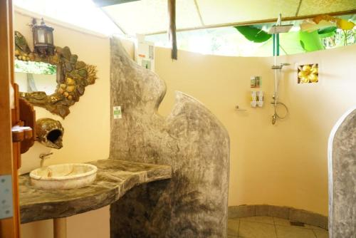 A bathroom at Eco-Logic, Resort for Charity