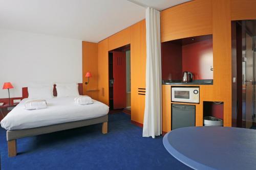 Un ou plusieurs lits dans un hébergement de l'établissement Novotel Suites Nancy Centre