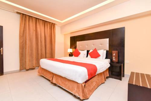 Cama ou camas em um quarto em OYO 462 Masar Najd
