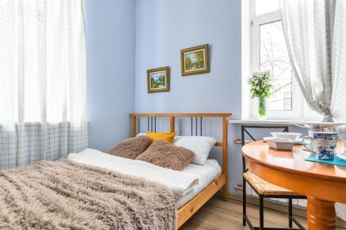 Кровать или кровати в номере RentalSPb 4 Studio Antonenko