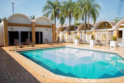 The swimming pool at or near ibis Styles Rio Preto Monte Libano