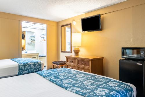 A television and/or entertainment center at Knights Inn - Maingate Kissimmee