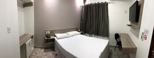 Cama ou camas em um quarto em Hotel Colorado