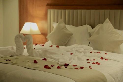 Cama ou camas em um quarto em Amaken Aparthotel