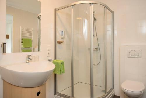 Een badkamer bij Hoevehotel 'Hof Christina'