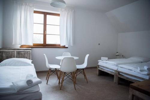 A bed or beds in a room at Dvůr Perlová voda