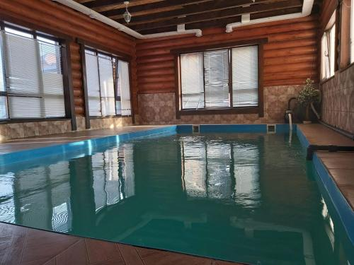 The swimming pool at or near Guest House Banya na Drovakh