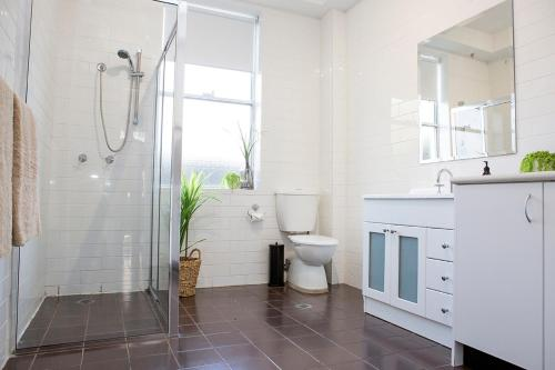 A bathroom at Revive Central Apartments