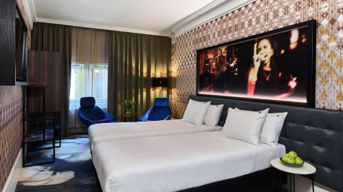 A bed or beds in a room at Hard Rock Hotel Amsterdam American