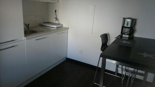 A kitchen or kitchenette at TOP Appartement !