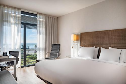 A bed or beds in a room at AC Hotel by Marriott Gava Mar Airport
