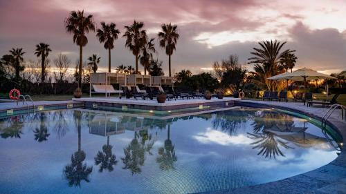 The swimming pool at or near AC Hotel by Marriott Gava Mar Airport