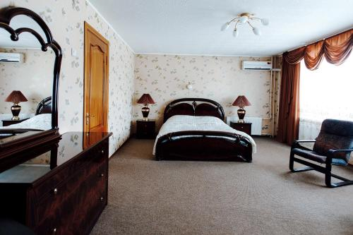 Кровать или кровати в номере Гостиница Спасская Вологда