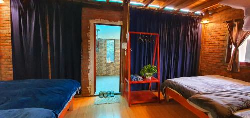A bed or beds in a room at The Little Hmong House