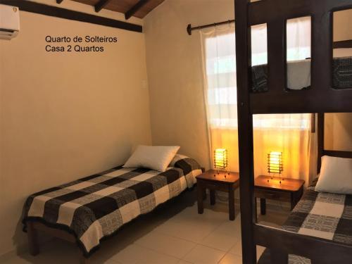 Cama ou camas em um quarto em Condominio dos Nativos