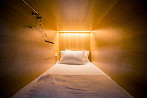 A bed or beds in a room at M Boutique Hostel