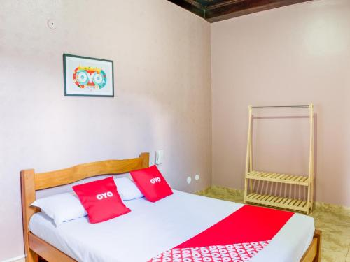 A bed or beds in a room at OYO Hotel Lindoia