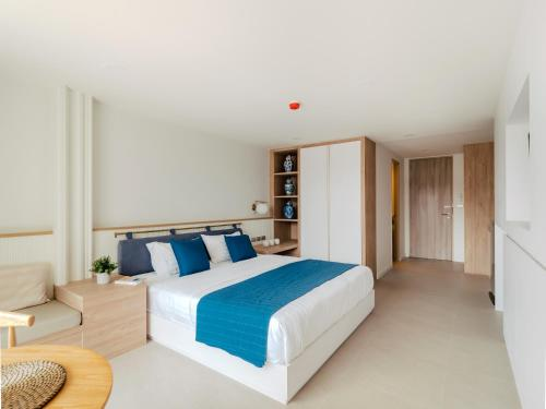 A bed or beds in a room at Blu 395