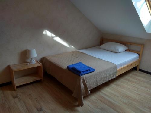 Кровать или кровати в номере Парк-Отель Риверсайд