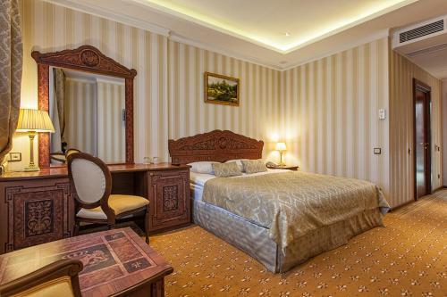 Кровать или кровати в номере Royal Hotel Spa & Wellness