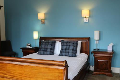 A bed or beds in a room at Craiglynne Hotel