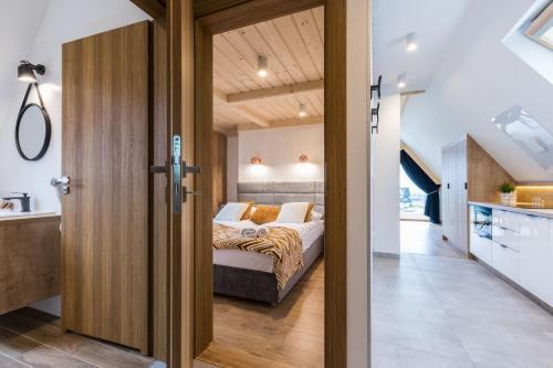 A bed or beds in a room at Góralska Rezydencja