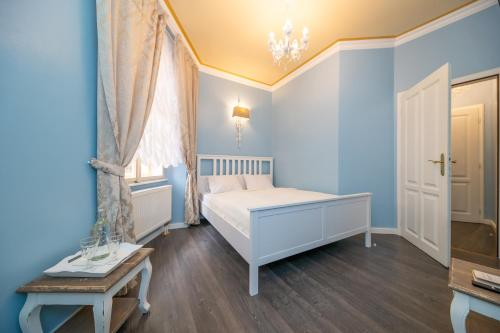 A bed or beds in a room at Cathedral Prague Apartments