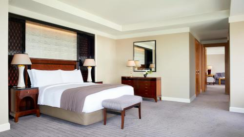 A bed or beds in a room at The Ritz-Carlton, Tokyo