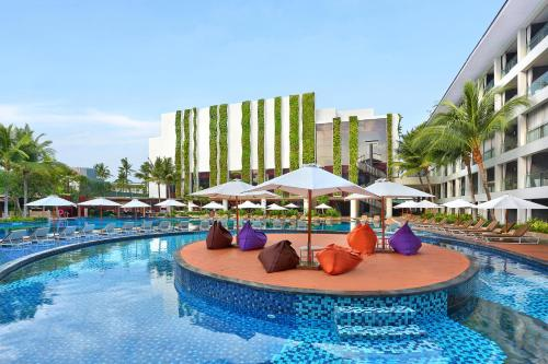 The swimming pool at or near The Stones - Legian Bali, Marriott's Autograph Collection Hotel