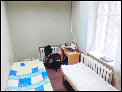 Ліжко або ліжка в номері Cinema Comfort City Hostel