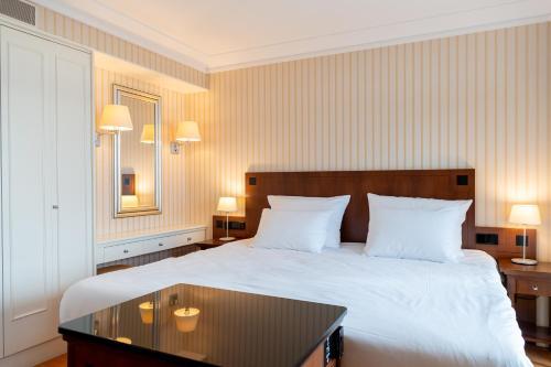 Un ou plusieurs lits dans un hébergement de l'établissement Van der Valk Palace Hotel Noordwijk