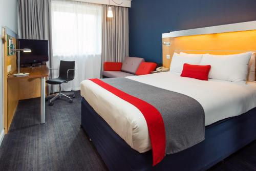 A bed or beds in a room at Holiday Inn Express Stevenage, an IHG Hotel