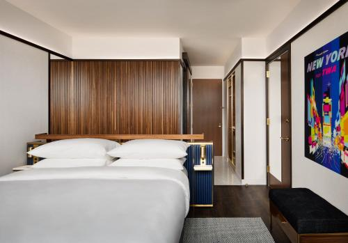 A bed or beds in a room at TWA Hotel at JFK Airport