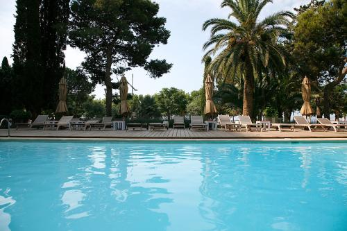 The swimming pool at or near Hotel Trias