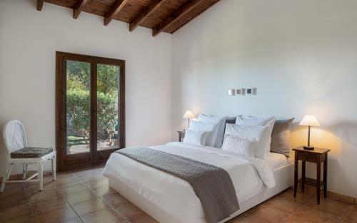 Ένα ή περισσότερα κρεβάτια σε δωμάτιο στο Marina's Paradise Summer House