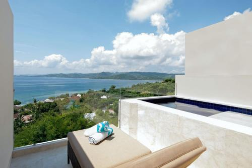 A balcony or terrace at Bukit Pool Suites Gili Gede