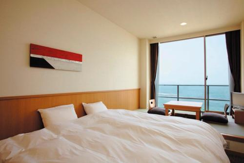 A bed or beds in a room at Bayside Square Kaike Hotel
