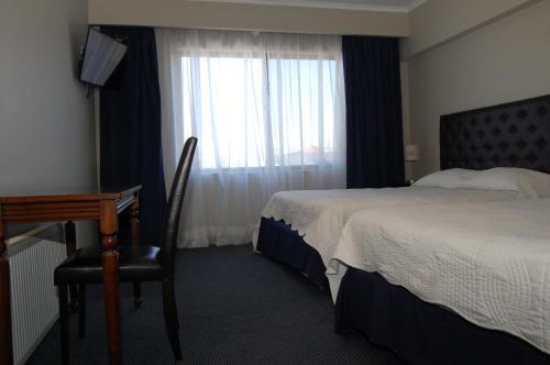 Cama o camas de una habitación en Hotel Econohotel