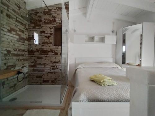Letto o letti in una camera di Villa Fanny Porto Pino
