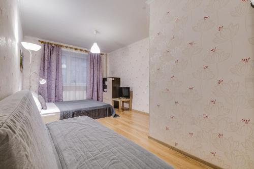 A bed or beds in a room at Щёлковские квартиры - Фряновское шоссе 64к2