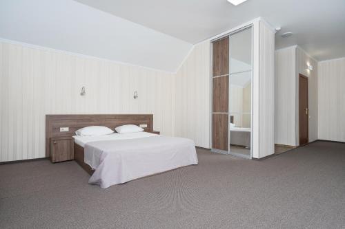 Кровать или кровати в номере Отель Регина Малые Клыки