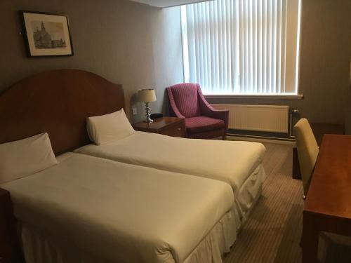 Cama o camas de una habitación en The Sir Thomas Hotel
