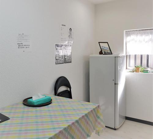A kitchen or kitchenette at 桜花之家 sakura guest house 天下茶屋2F