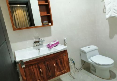 Um banheiro em Beauty Rose Hotel