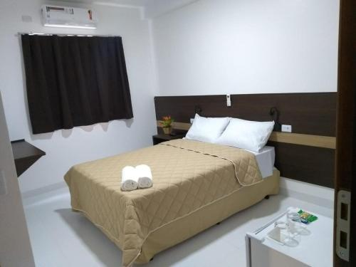 A bed or beds in a room at Executive Hotel