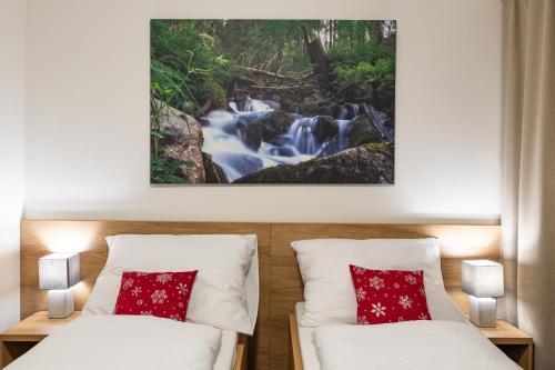 Posteľ alebo postele v izbe v ubytovaní Hotel Jasná