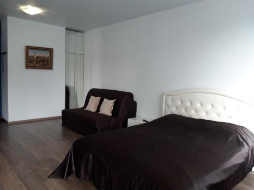 Кровать или кровати в номере Radius Central House апартаменты