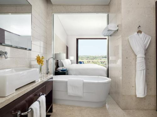 A bathroom at Cordis, Beijing Capital Airport By Langham Hospitality Group