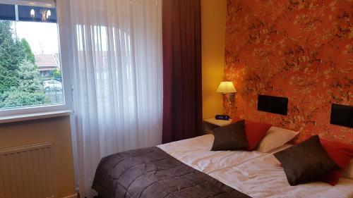 Een bed of bedden in een kamer bij De Vier Seizoenen