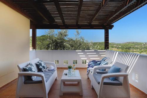 Balkon lub taras w obiekcie Seven Springs Villas